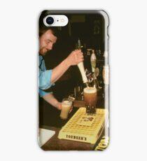 Landlord serving pints of beer, UK, 1980s. iPhone Case/Skin