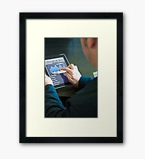 Closeup of a businessman accessing his digital tablet PC Framed Print