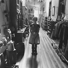Black and White Photo of Little Girl in the Hallway by Marcie Alban