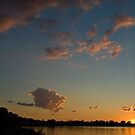 Sunset over the water by Dave Riganelli