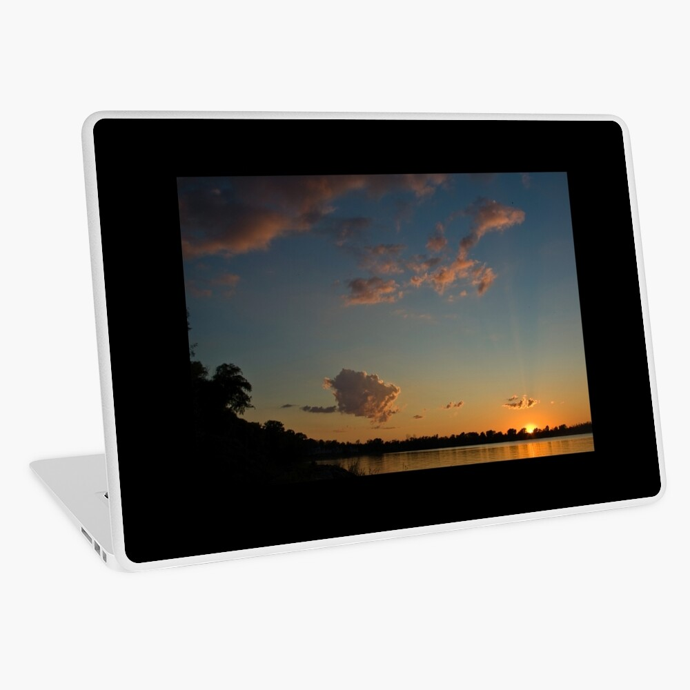 Sunset over the water Laptop Skin
