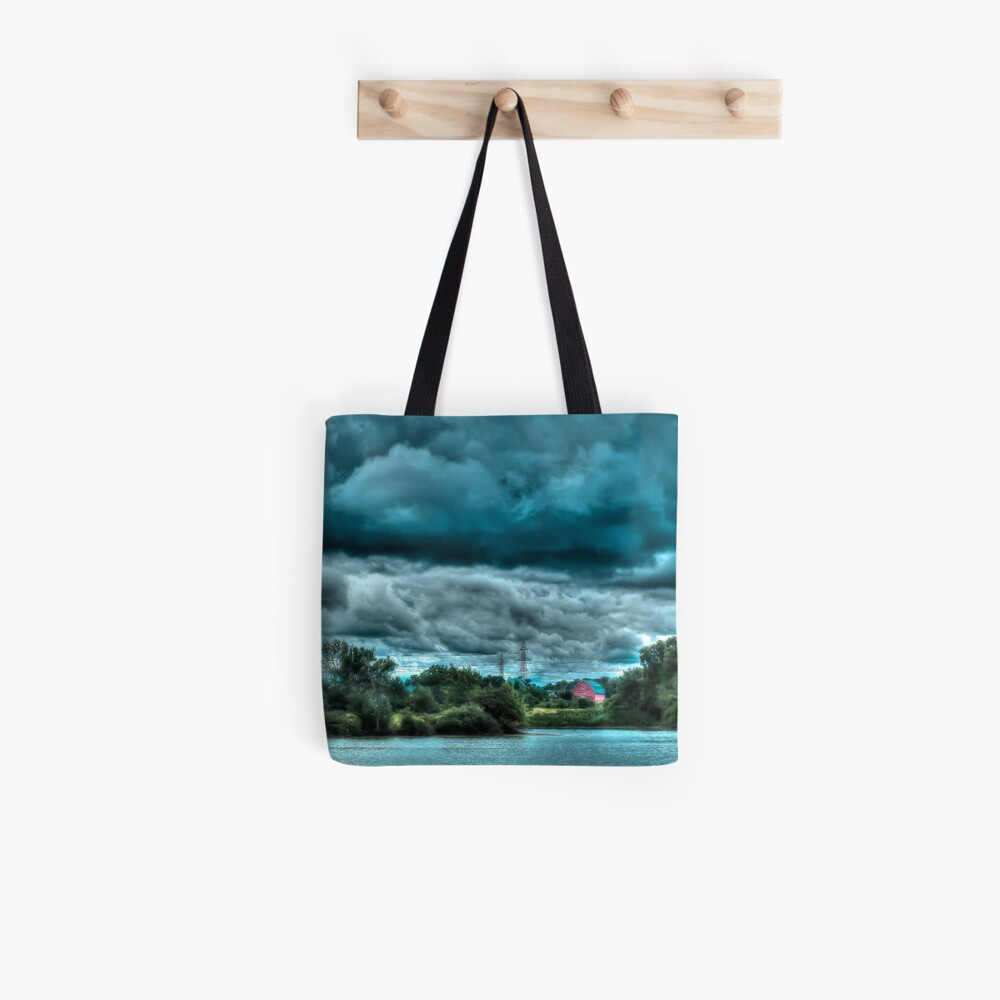 Red barn under cloudy sky Tote Bag
