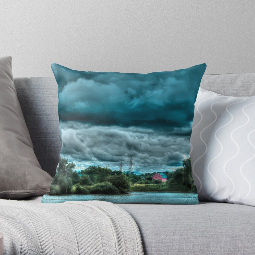Red barn under cloudy sky Throw Pillow
