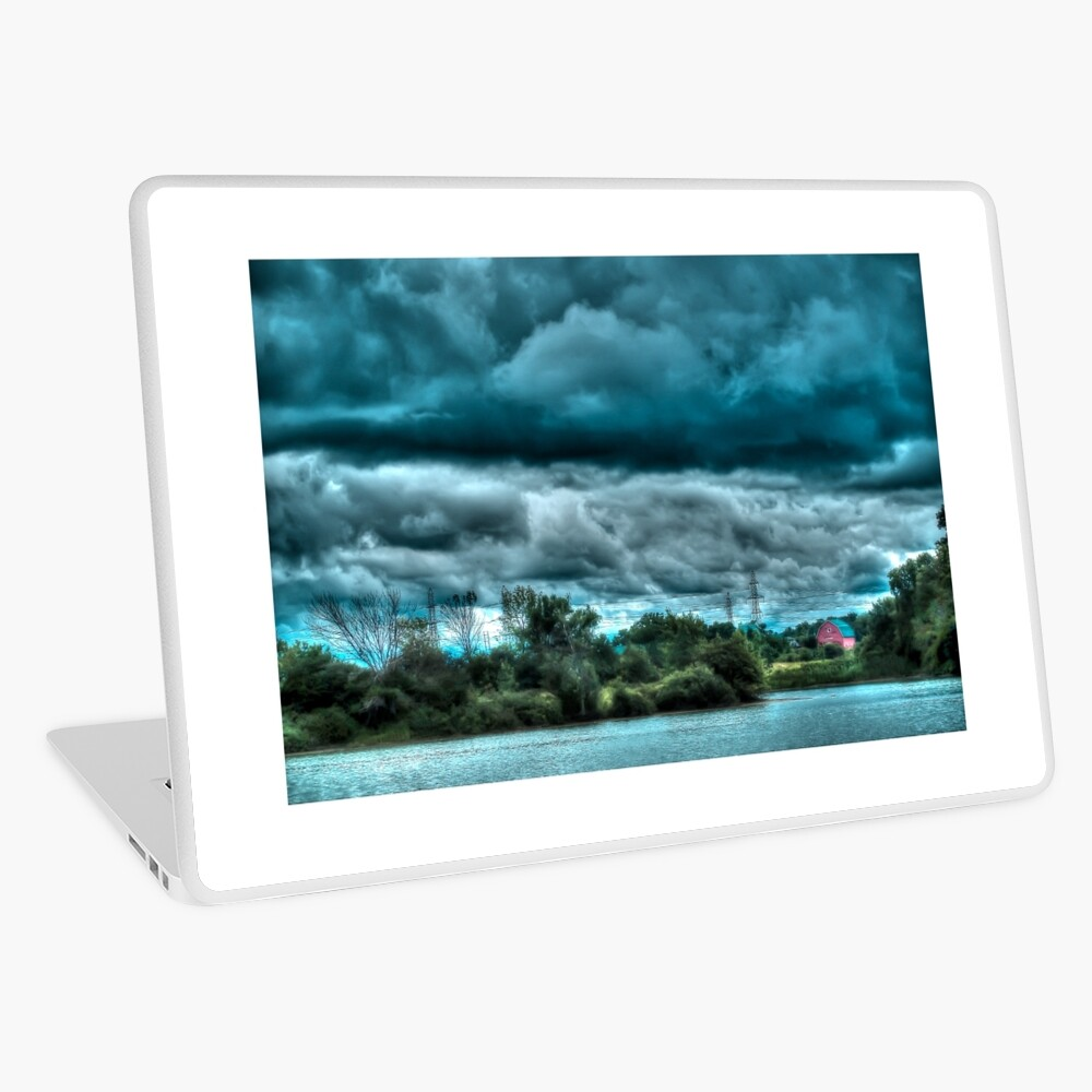Red barn under cloudy sky Laptop Skin