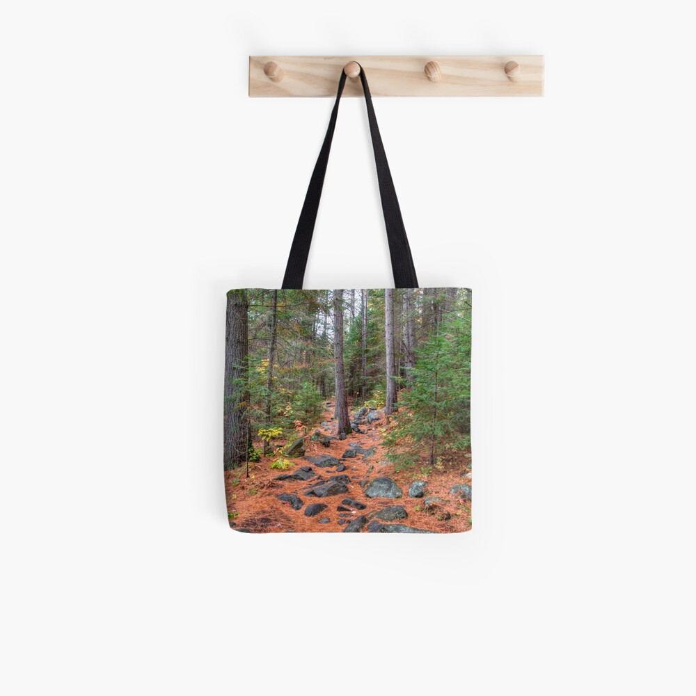 Rocky path through the pine forest Tote Bag