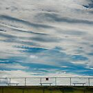Clouds and fence by dcarphoto