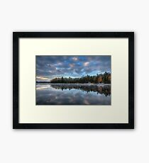 Reflected trees and sky Framed Print