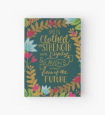 Cuaderno de tapa dura Ella está vestida de fuerza y dignidad y se ríe sin miedo al futuro, floral