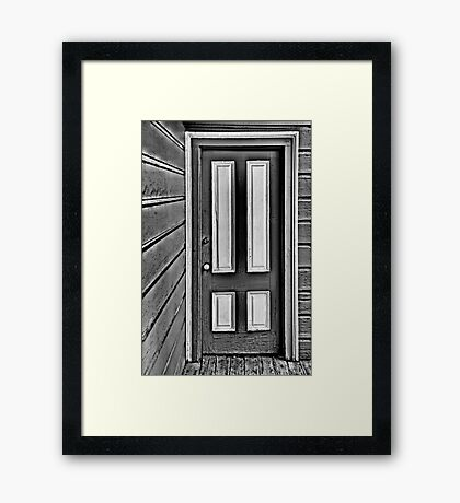 The Old Gray and White Door Framed Print
