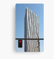 red traffic light in the city Canvas Print