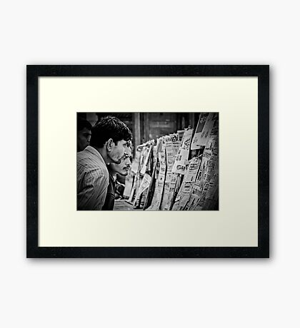 Men and The News II Framed Print