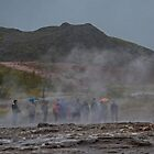 Tourists at Geothermal Area in Iceland on a Rainy Day  by Gerda Grice