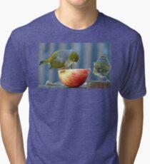 Holding the Apple Up! - Wax Eye NZ - Southland Tri-blend T-Shirt