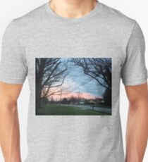Blue and pink sky with trees and grass T-Shirt