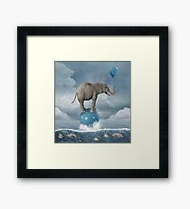 Elephant in the middle of the sea Framed Print