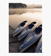 Kayak canoe boats at lake shore in morning fog Photographic Print