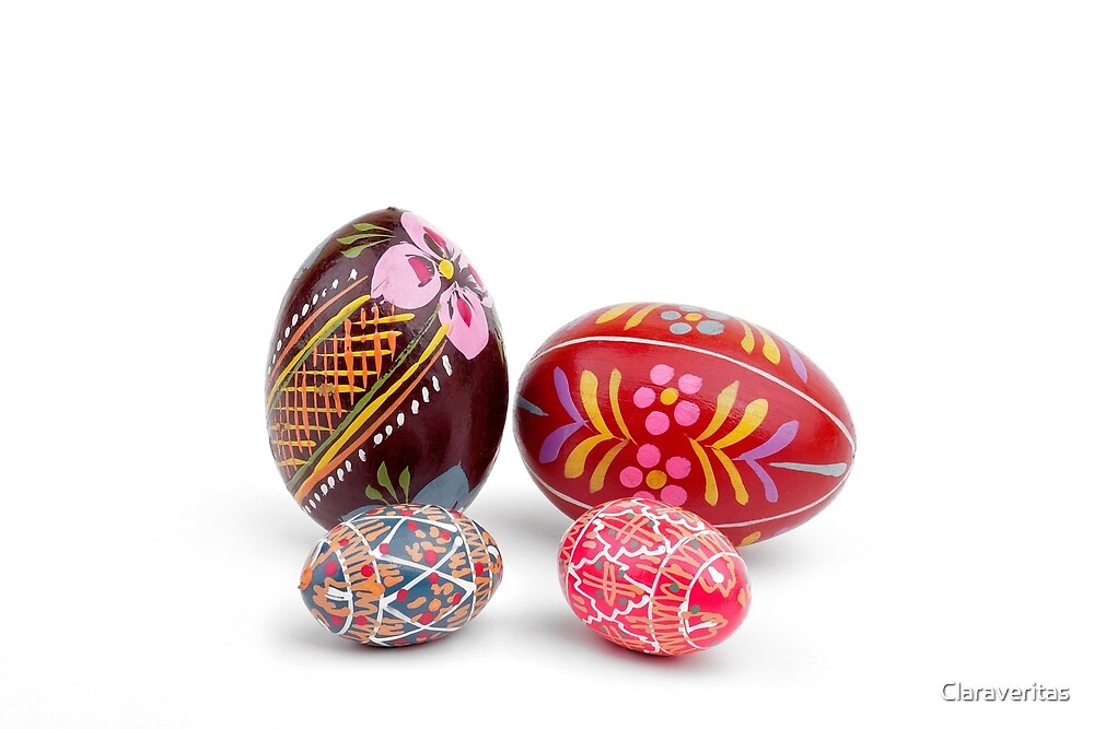 hand painted easter eggs on white table by Artur Mroszczyk