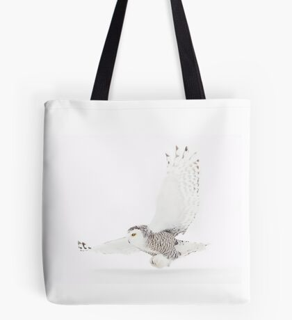 A snowy owl lands Tote Bag