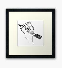 drawing hand Framed Print