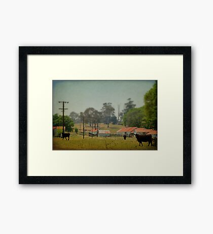 In The Village Framed Print