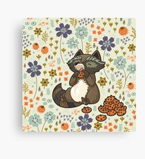 Funny little raccoon eating cookies Canvas Print