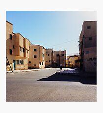 Man Riding Bicycle Through Moroccan Suburb Photographic Print