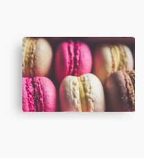 Colourful sweet tasty macaroons in a row Canvas Print