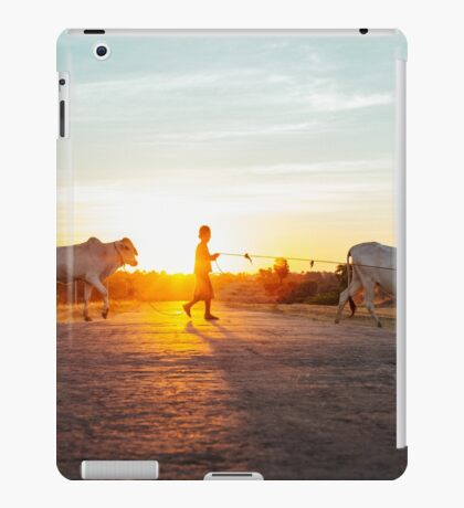 Silhouette of Boy Leading Cattle Across Road at Sunset in Burmese Countryside iPad Case/Skin