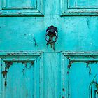 What lies behind the blue door by Clare Colins