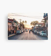 Sun sets in the village Metal Print