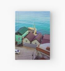 Many color houses on the coast of the sea Hardcover Journal