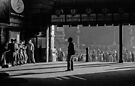 B & W Clockwatcher on entrance Flinders St station 19580904 0001 by Fred Mitchell