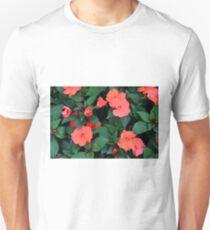 Red orange flowers in the green bush. Unisex T-Shirt