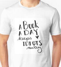 A book a day keeps idiots away Unisex T-Shirt