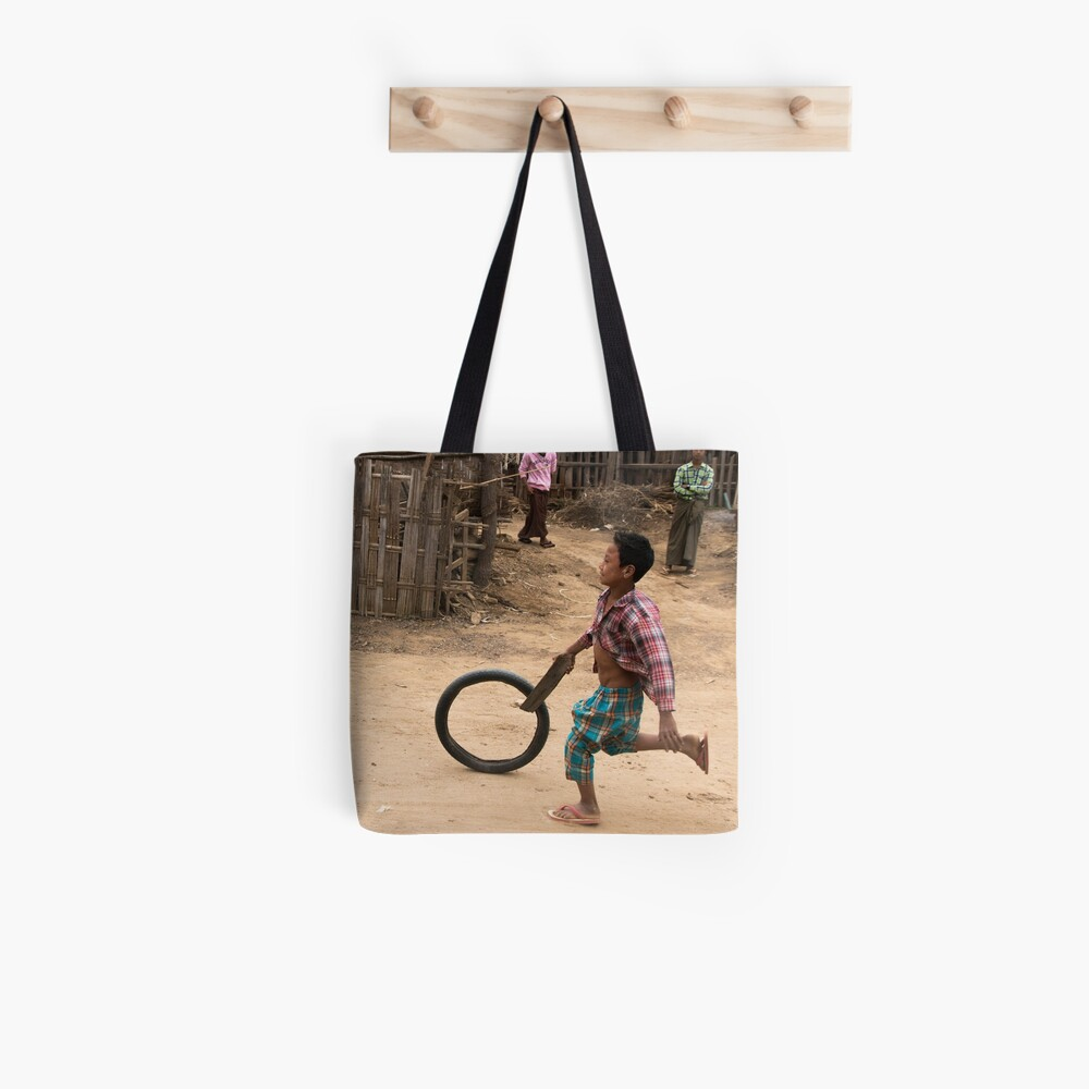 A Child Playing With A Wheel in Myanmar Tote Bag