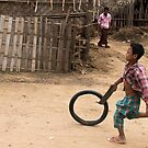 A Child Playing With A Wheel in Myanmar by Clara Go (missatgerebut)