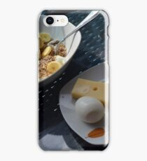 A bowl of cereals and yogurt and a plate with cheese and eggs. iPhone Case/Skin