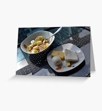 A bowl of cereals and yogurt and a plate with cheese and eggs. Greeting Card