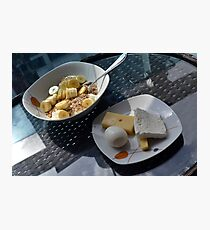 A bowl of cereals and yogurt and a plate with cheese and eggs. Photographic Print