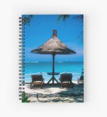 Beach umbrella and recliners, Bali, Indonesia. Spiral Notebook