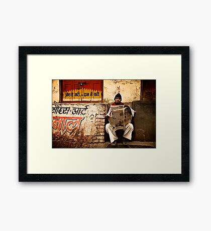 Buried in the Paper Framed Print