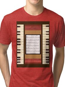 Piano keys with sheet music by Kristie Hubler Tri-blend T-Shirt