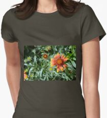 Orange flower and green leaves background. Womens Fitted T-Shirt