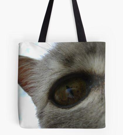 in a cat's eye Tote Bag