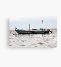 Moored Fishing Boat and Pelicans Canvas Print