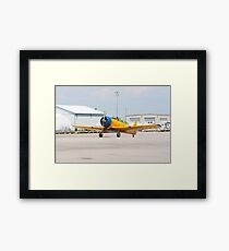 Single engine trainer North American Harvard IV rolling to location for stop. Framed Print