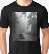 A vintage Girl with tricycle in the foggy woods. T-Shirt