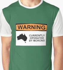 WARNING: CURRENTLY OPERATED BY MORONS Graphic T-Shirt