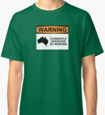 WARNING: CURRENTLY OPERATED BY MORONS Classic T-Shirt