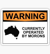 WARNING: CURRENTLY OPERATED BY MORONS Sticker